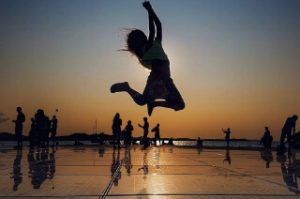 silhouette of person jumping off the monument to the sun in zadar croatia