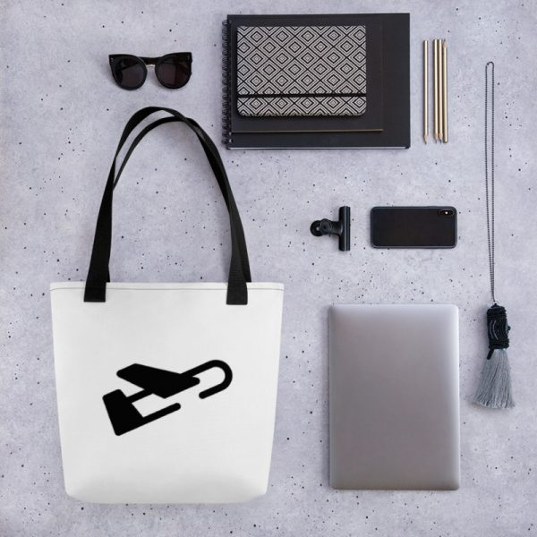 White tote bag with black handles featuring the Burdie plane logo, set next to essentials items like a laptop and notebook.