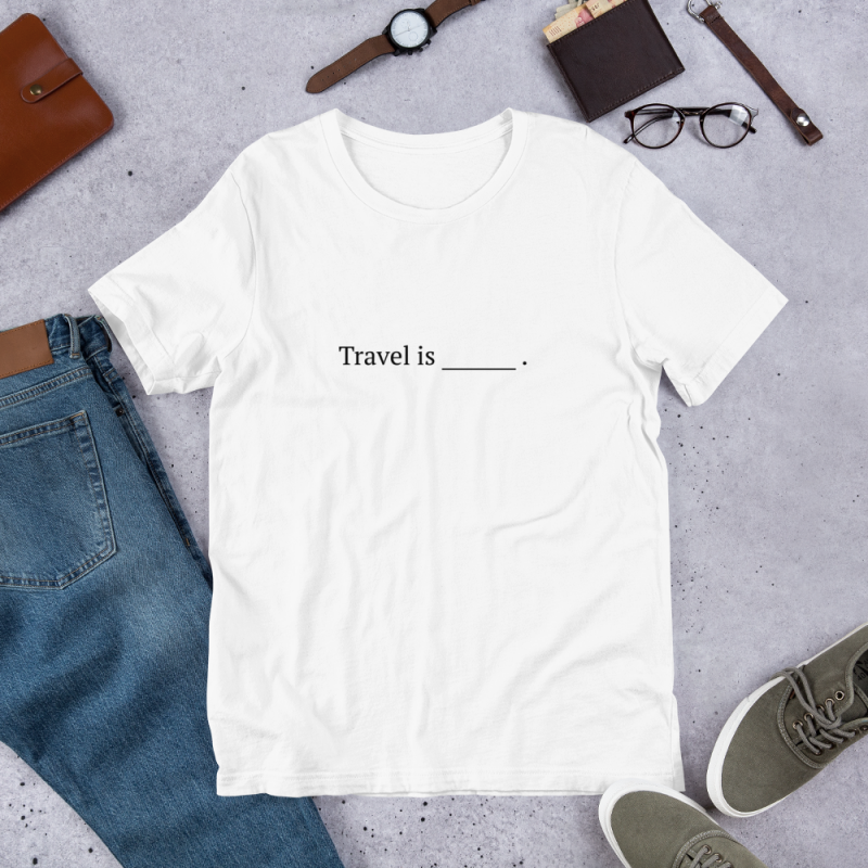 "White tshirt with ""travel is blank line"" written in black."