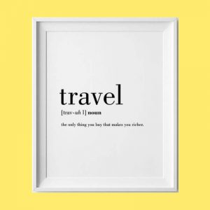 "High quality white poster that defines travel as ""the only thing that makes you richer"" in black ink"