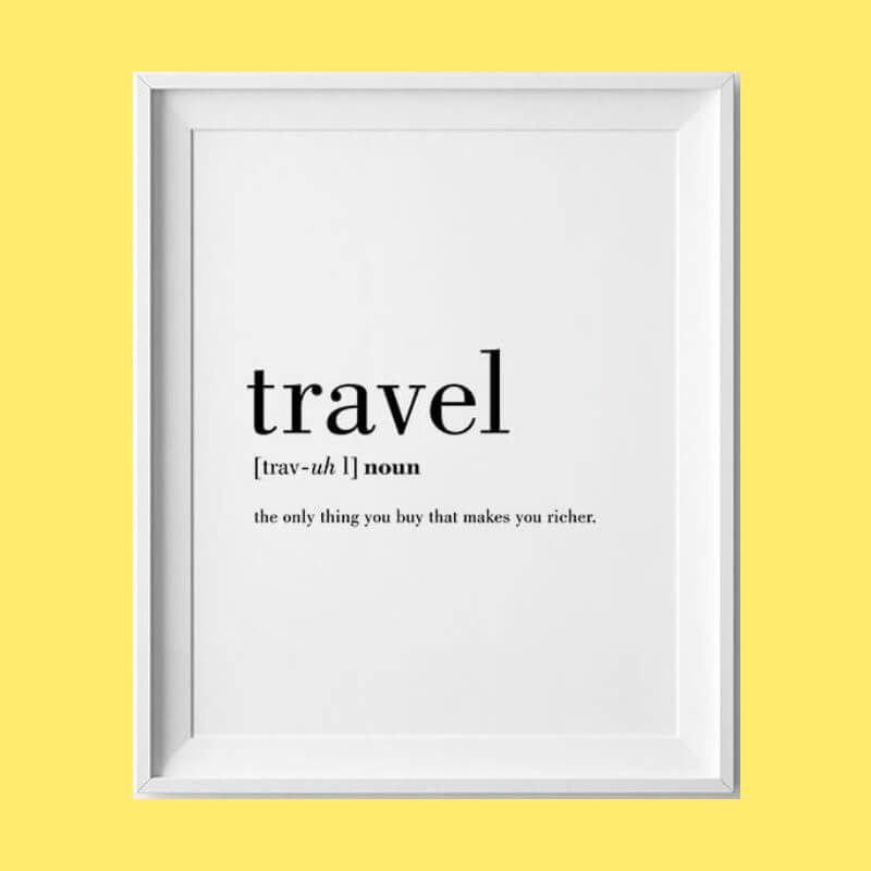 """High quality white poster that defines travel as """"the only thing that makes you richer"""" in black ink"""