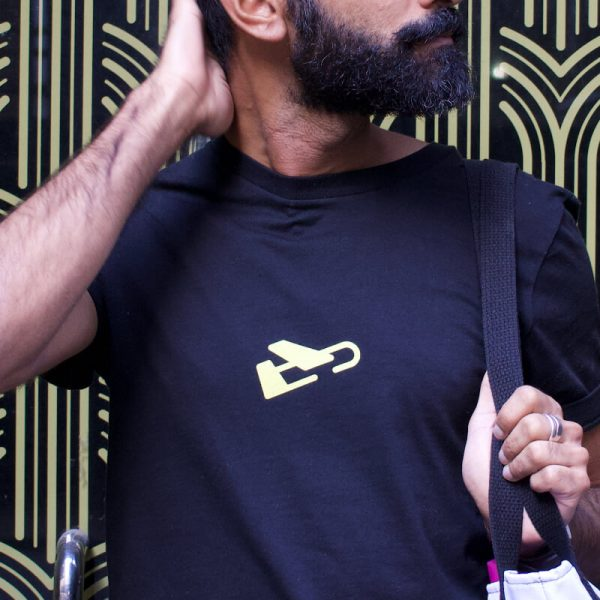 Bearded man models black tshirt with yellow plane logo