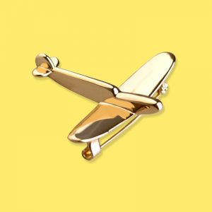 Golden brooch pin of fighter plane