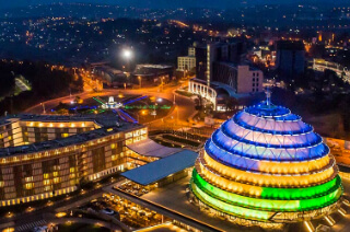 Kigali from above at night with a lit up convention centre